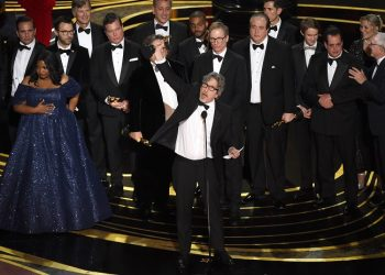 """Peter Farrelly, center, and the cast and crew of """"Green Book"""" accept the award for best picture at the Oscars on Sunday, Feb. 24, 2019, at the Dolby Theatre in Los Angeles. (Photo by Chris Pizzello/Invision/AP)"""
