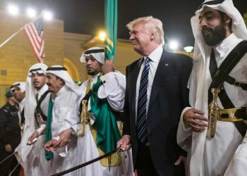 US President Donald Trump joins dancers with swords at a welcome ceremony ahead of a banquet at the Murabba Palace in Riyadh on May 20, 2017. / AFP PHOTO / MANDEL NGAN (Photo credit should read MANDEL NGAN/AFP/Getty Images)