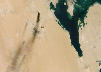 epa07844126 A handout photo made available by NASA Worldview shows a satellite image of smoke from fires at two major oil installations in eastern Saudi Arabia, 14 September 2019 (issued 15 September 2019), following alleged drone attacks claimed by Yemen's Houthi rebels. According to Saudi state-owned oil company Aramco, two of its oil facilities in Saudi Arabia, Khurais and Abqaiq, were set on fire on 14 September after allegedly having been targeted by drone attacks. In picture is seen Bahrain (island, top) and Qatar (peninsula, R). EPA-EFE/NASA WORLDVIEW HANDOUT HANDOUT EDITORIAL USE ONLY/NO SALES