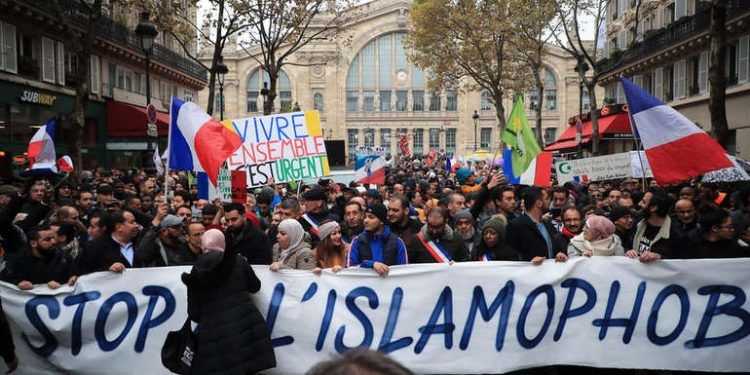 epa07986133 People and members of anti-racism associations gather to protest against Islamophobia at the Gare du Nord in Paris, France, 10 November 2019. Protesters gathered to protest against the anti-Muslim acts in France. The demonstration was called by the Collective Contre l?Islamophobie in France (CCIF), following an attack against a mosque in Bayonne on 28 October where an attacker killed two people that tried to stop him from setting a fire at the doors of the mosque. EPA-EFE/CHRISTOPHE PETIT TESSON