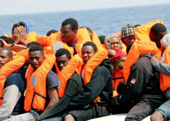 epa06638906 Migrants sit aboard a rubber dinghy of rescue ship 'Aquarius' off the Libyan coast, 31 March 2018. NGOs 'Medecins Sans Frontieres' (Doctors Without Borders, MSF) and 'SOS Mediterranee' say they have rescued more than 250 people on 30 and 31 March. The migrants were drifting in two rubber boats off the coast of Libya, according to an Efe source on board the rescue ship Aquarius. EPA-EFE/Javier Martin